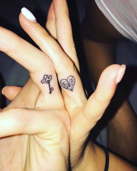 Matching lock and key finger tattoos by Melinda Balogh