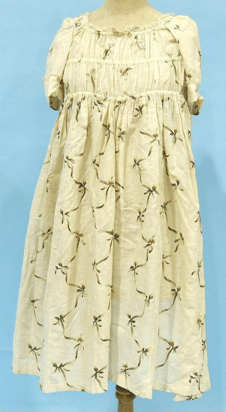 Child's dress, late 18th century. White lawn embroidered in coloured silks with flowers and ribbons.