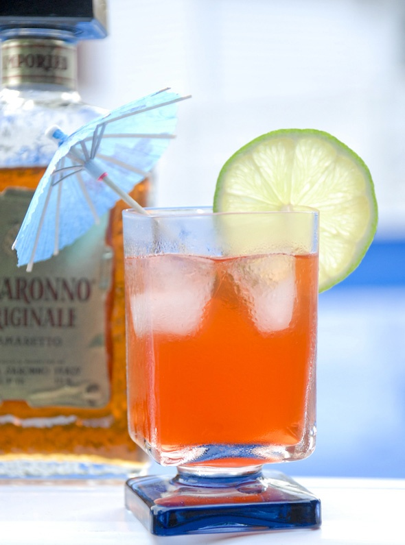 DISARONNO ITALIAN BREEZE  ---   • 1 part Disaronno  • 1 part white rum  • 2 parts pineapple juice  • 2 parts cranberry juice  • Shake all ingredients with ice and strain into a glass filled with ice  • Garnish with a lime slice
