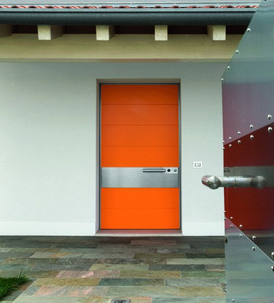 Orange Synua pivot door in RAL lacquered with stainless steel sector by Oikos Venezia.  www.oikos.it