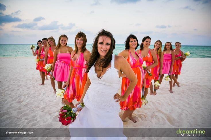 Bridesmaids in colorful pink and orange dresses at Isla de la Pasión. http://dreamtimeimages.com/blog/passion-island-wedding-photography-isla-del-passion-mexico-kelly-jason/