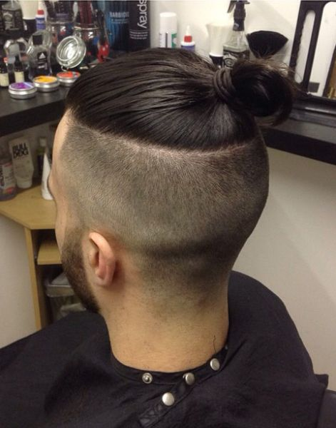 Men's grad crop with no side blending using mens grooming creme and spray on shine.