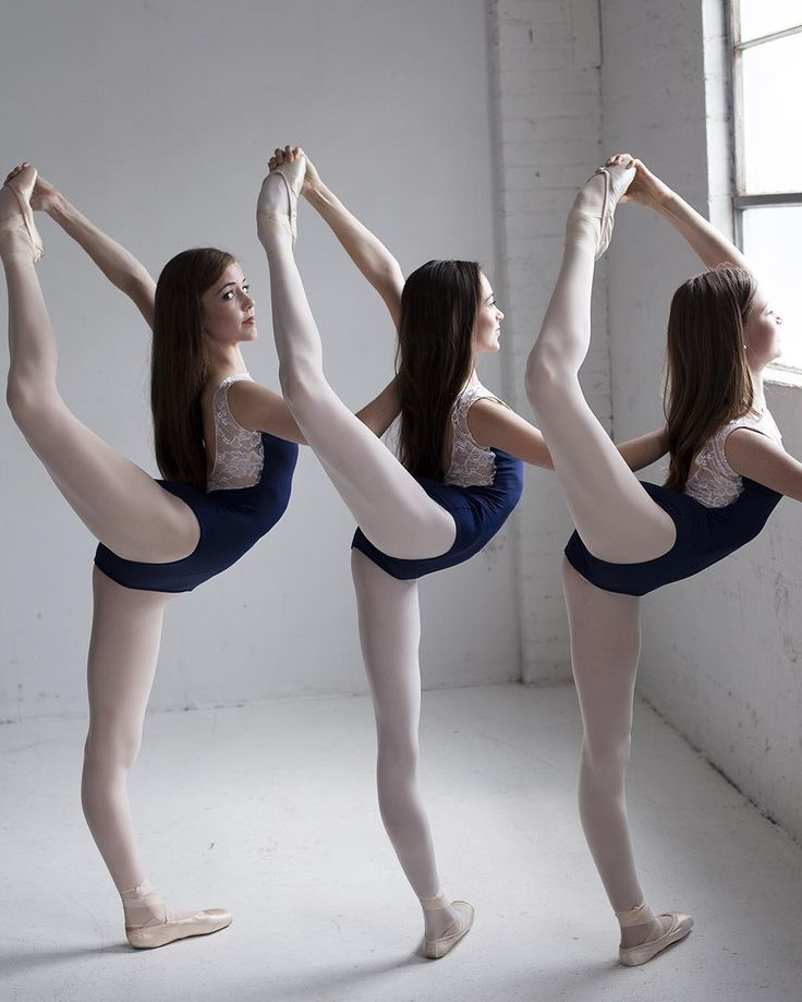 Dance photography captures three ballerinas stretching for ballet class in their Luckyleo Dancewear