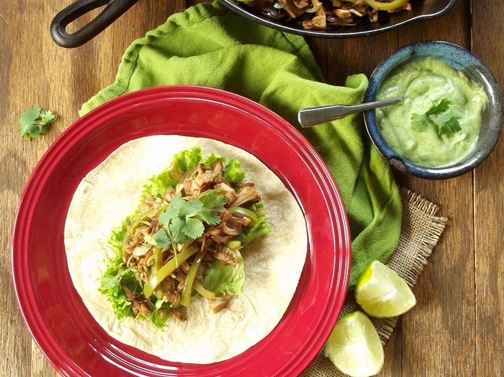Vegan jackfruit fajitas made with pulled jackfruit, onions and peppers in a spicy-smokey marinade and dressed with avocado cilantro cream.