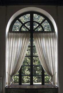 I like the pole 1/3 down on this Arched window.