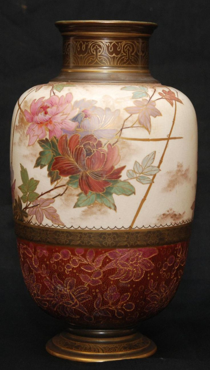 An antique Royal Doulton Burslem English porcelain footed vase. Has a beautiful hand painted floral design over ivory and deep pink grounds. Brown grounds to neck, foot and band to body. Area with pink ground has an interesting textured lizard scale design