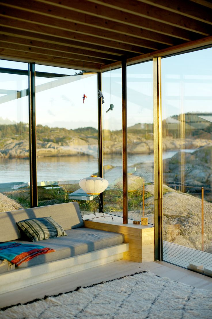 Slender stilts anchor this family summer house by Lund Hagem to the rocky edge of a Norwegian island