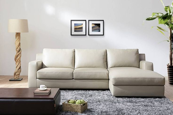 Light%20cream%20color%20sectional%20with%20a%20sofa%20bed%20system%20and%20storage.%20Eye%20catching%20and%20modern,%20this%20light%20grey%20section%20features%20100%%20Italian%20leather%20upholstery%20and%20a%20bold%20design.%20Stitched%20geometric%20leather%20on%20the%20armrests%20adds%20a%20neoclassical%20touch%20this%20luxury%20large%20sectional,%20which%20comes%20with%20large%20storag...%20