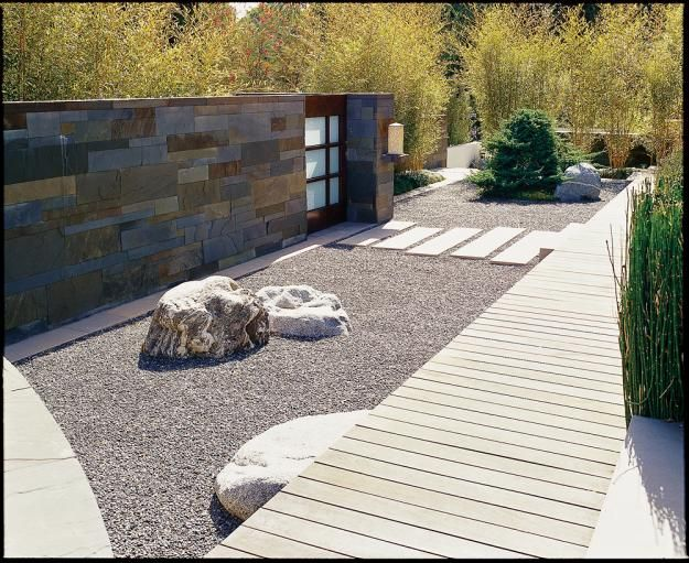 Try a modern japanese dry garden. Great idea for hot and dry weather conditions. Use some appropriately selected pots with really exotic floral arrangements to add some color. Use a hidden drip line to keep them watered in some properly placed pottery. Elegant, nice, easy to maintain and relaxing to enjoy. A great place to nap or read.