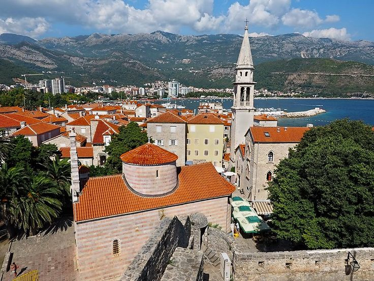 Medieval walled city of Budva, Montenegro, with Church of the Holy Trinity in the foreground and the bell tower of the Church of St. John