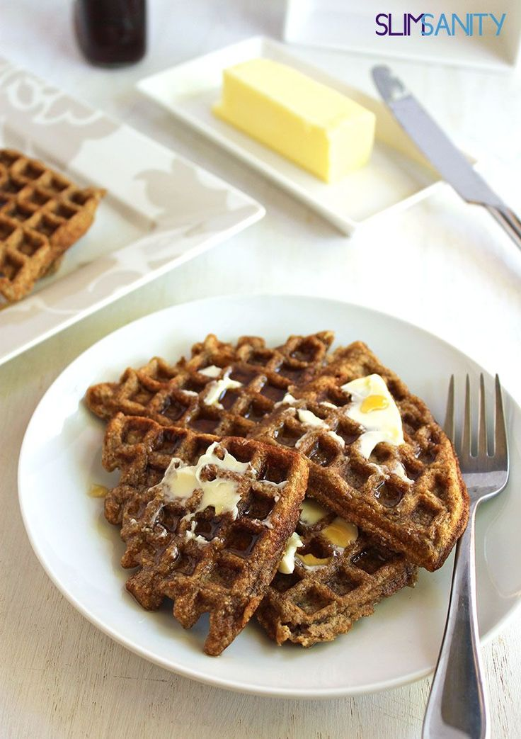 Whole wheat applesauce waffles - fluffy waffles make for a healthy breakfast, even served with real maple syrup and butter! | slimsanity.com