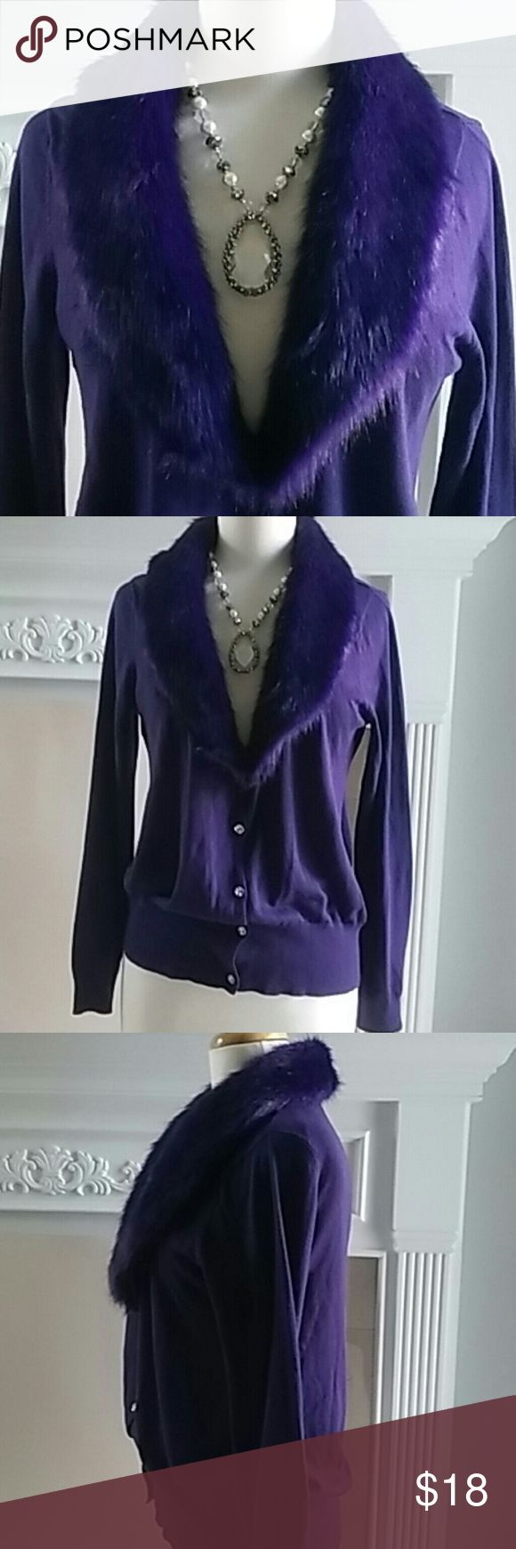 ROZ & ALI PURPLE SWEATET FAUW FUR COLLAR S. L ROZ & ALI ROYAL PURPLE SWEATER WITH LAVISH FAUX FUR COLLAR & BUTTONS THAT SPARKLE LIKE DIAMONDS. COTTON ACRYLIC BLEND. WORN A FEW TIMES BUT STILL IN GREAT CONDITION. PERFECT FOR THE HOLIDAY SEASON. SIZE. LARGE Roz & Ali Sweaters Cardigans