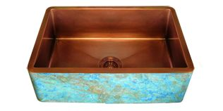 copper apron farmhouse sink with a custom turquoise verdigris finish