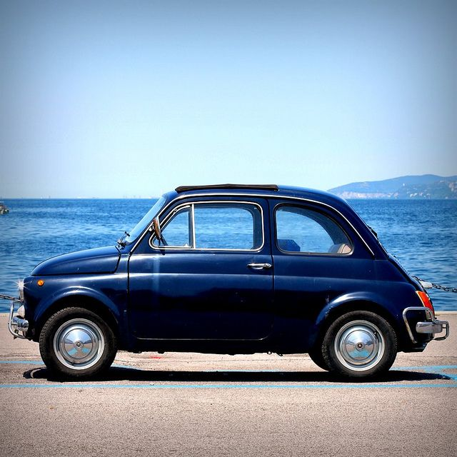 Fiat Cinquecento walking on sunshine:-) my first car was a fiat not this one but real similar. love cars....