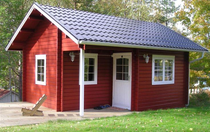 Punainen tupa ja perunamaa. - Traditional red cottage & potato patch.