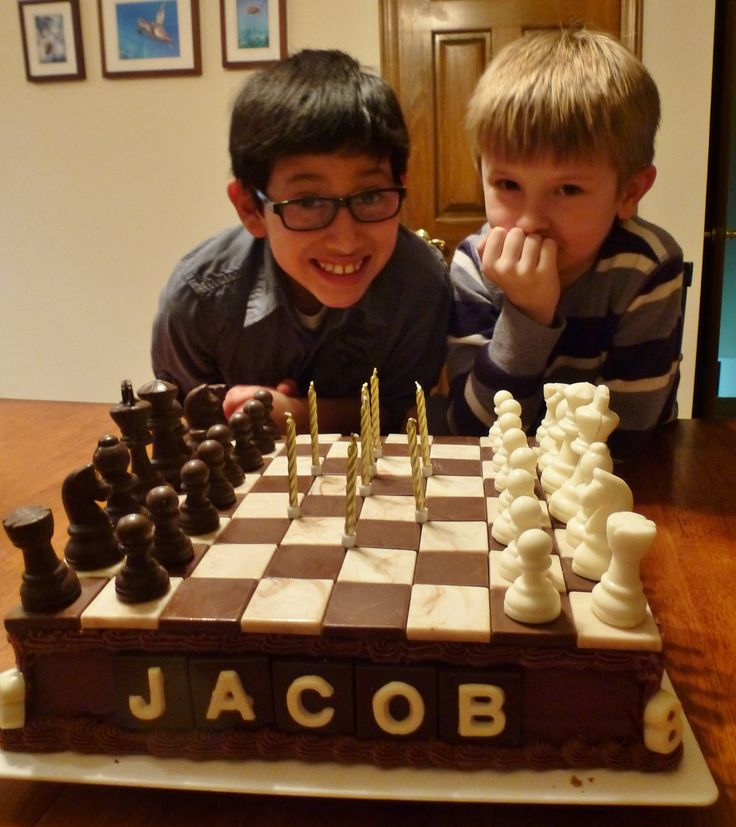 This chess board cake was created for my grandson who is on the chess team at his school.  I used candy molds for both the squares and the playing pieces.  Time consuming, but easy enough to create.