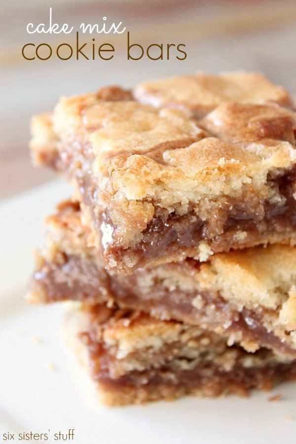 These Cookie Bars are the perfect blend of soft and crunchy. The chocolatey peanut butter middle tastes great mixed with the white cake mix base!