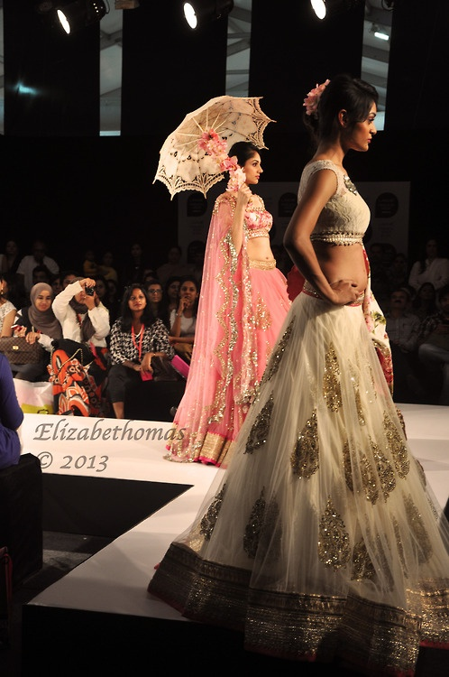 Indian Fashion Week.  sparkles on white & umbrella