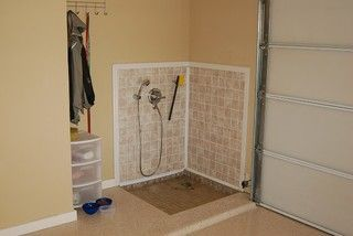 Garage dog wash. Good idea if you don't have room in your home for a dog shower. #cleangarage