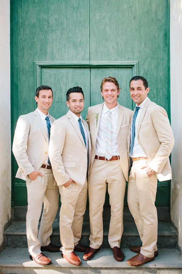 Khaki pants, brown belts & shoes, white shirt for groom, blue shirts for groomsmen