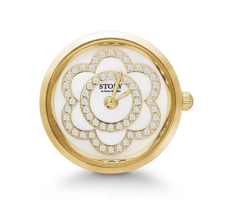 STORY ur i forgyldt stål med smukke swarovski krystaller der er formet som en blomst. Et super flot ur der selvfølgelig kan sættes på alle STORY armbånd. #storywatch #kranzogziegler #story #storybykz