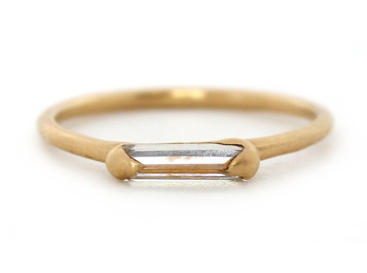 Caged Lrg single Baguette halo ring front view 18Y