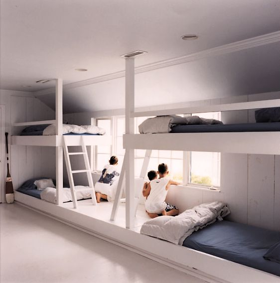 Bunk room in attic space. Built-in fits around the slatted ceilings!