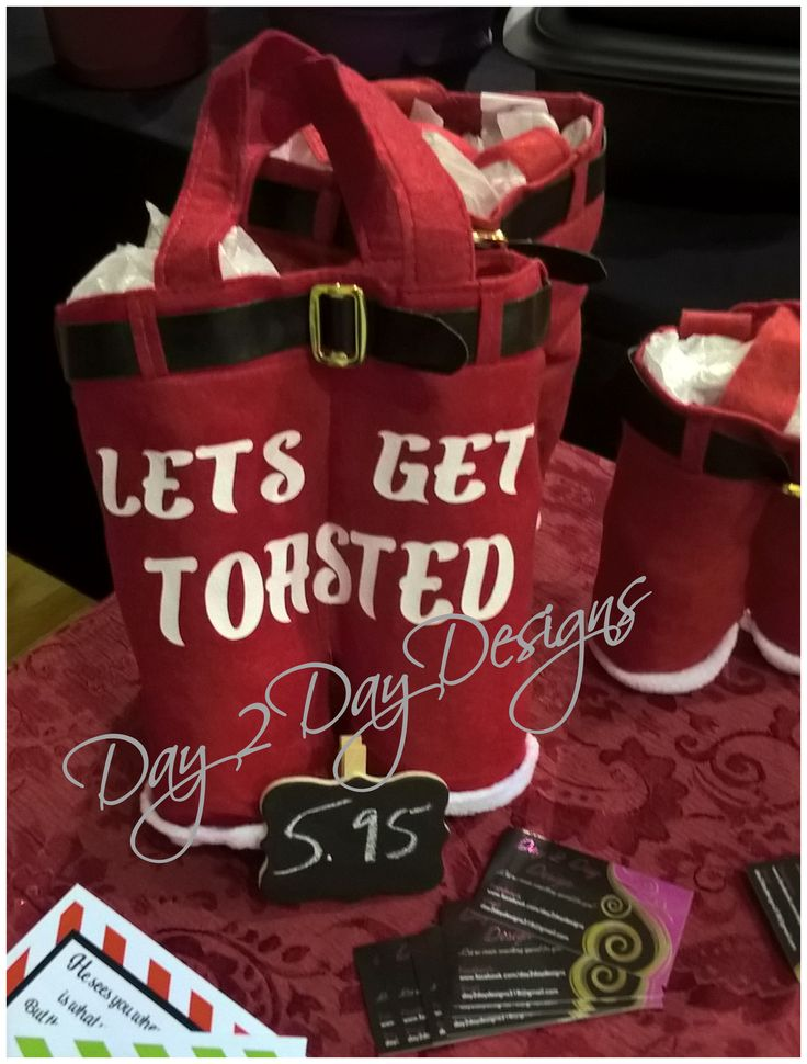 Large Santa Pants Let's Get Toasted. Large enough to hold 2 bottles of wine. From Day 2 Day Designs #day2daydesigns Follow us on Instagram, Pinterest and Facebook.
