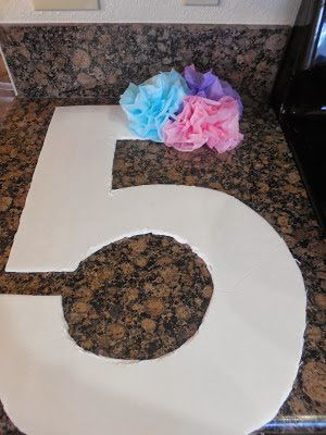Tissue Paper Craft Large letters and numbers cut out from Dollar Tree form core and decorated with tissue poms.
