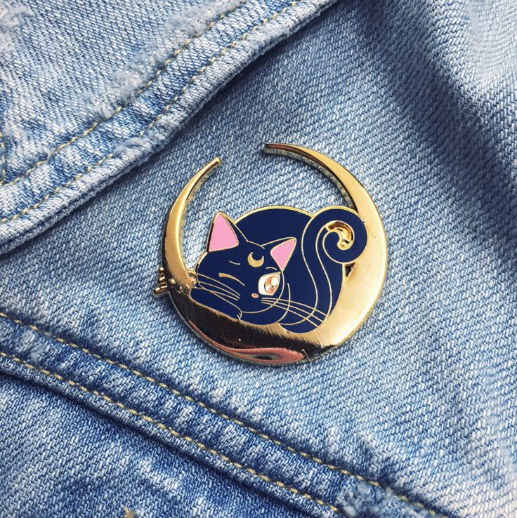 She's a cutie, she's Sailor Moon sidekick and one of her best friends! She can now be yours too, as soon as she's done napping of course... Embrace the lunar power and your inner moonie with this cute pin!⩺ Extra large 37mm width, hard enamel pin (1,46 in)⩺ 2mm thick⩺ Gold plated Brass⩺ Rubber pin backIf postage isn't listed for your country just contact me. Happy shopping!