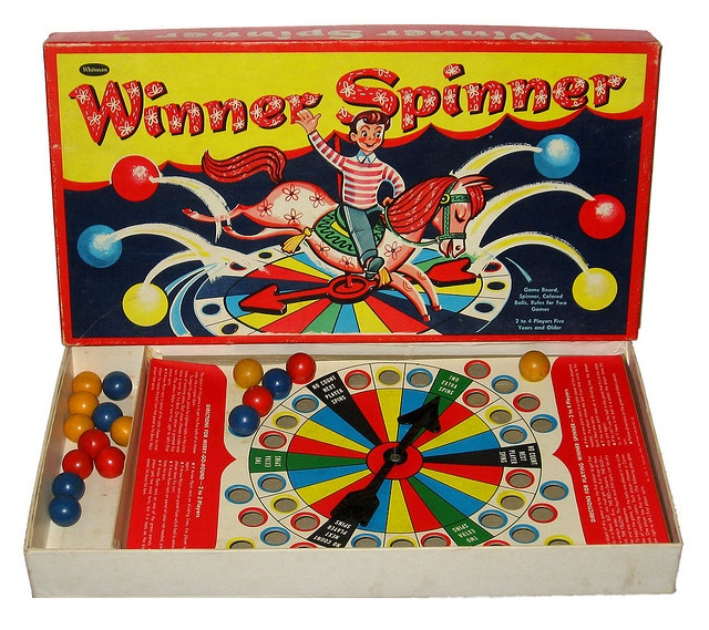 Old Board Games with cute graphics and wooden pieces.  I have this game - Winner Spinner.