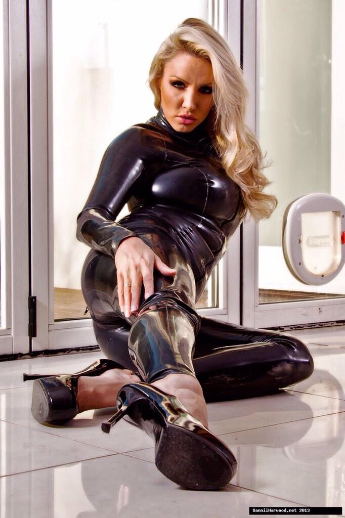 image Dannii smoking in catsuit not mine but too hot to not put up