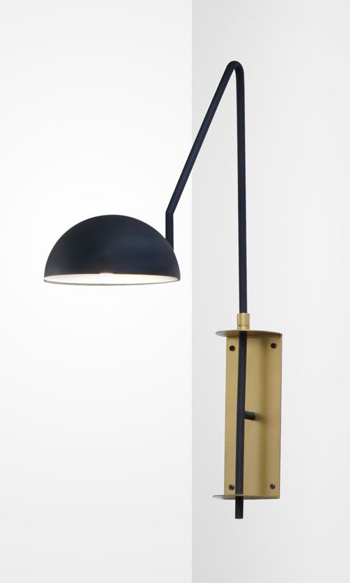 Brass and black sconce brassisback