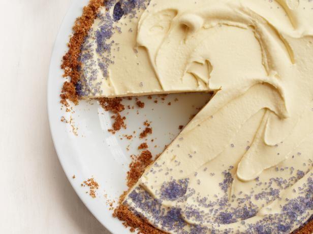 Lavender Ice Cream Pie Recipe from Food Network | spring, summer, heavy cream, milk, lavender honey, sugar, lavender, salt, egg yolks, graham crackers, butter, purple coarse sugar