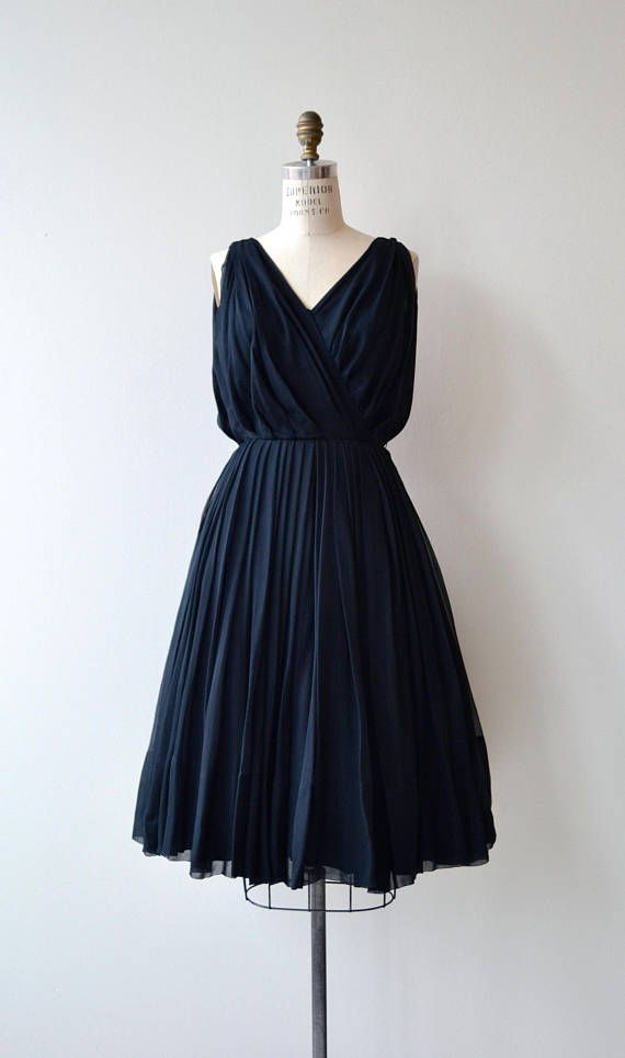 Vintage 1950s I. Magnin coal black silk chiffon dress with graceful pleated surplice bodice with subtle blouson effect, fitted waist, layered silk chiffon skirt, black lining and back metal zipper. --- M E A S U R E M E N T S ---  fits like: small bust: 34-36 waist: 26 hip: free length: 43