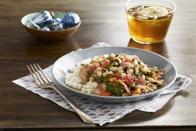 Ham and bacon lend their smoky goodness to black-eyed peas in this simple and delicious slow-cooker dish.