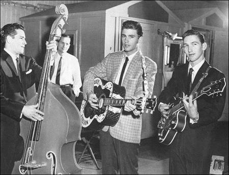 Rare 1957 picture of Ricky Nelson with an 18 year old James Burton on guitar and James Kirkland on bass. Missing are Richie Frost on drums and Gene Garf on piano. This was a a first class rock band...