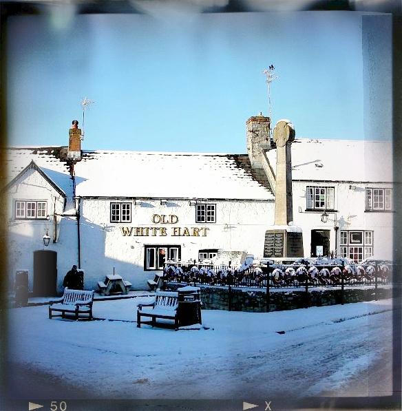Llantwit Major war memorial and pub behind it
