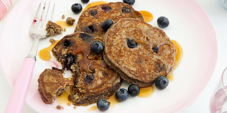 These pancakes feel indulgent but are packed with fibre and, with the added fruit on top, a hit of vitamin C! Details Serves 2 15 min prep time 15 min cooking time 288 calories per serve Ingredients 1/4 cup buckwheat flour (40g) 1 teaspoons baking powder (5g) 1/4 cup hazelnut meal (30g) 1/4 cup low fat milk (60g) 2 tablespoons reduced fat ricotta (40g) 1 cage free eggs (59g) 1 teaspoons vanilla bean paste (5g) 100g fresh blueberries 1g olive oil spray 2 teaspoons maple syrup (10g) Method…