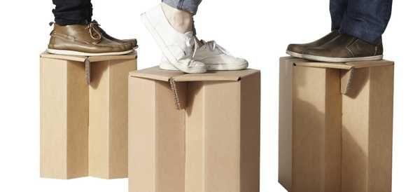 man standing on cardboard table