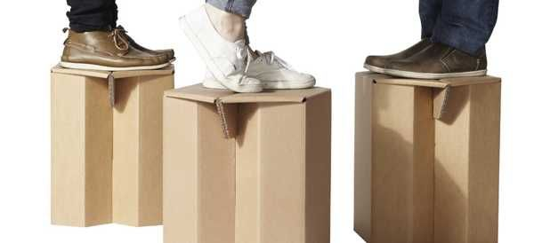 man standing on cardboard table