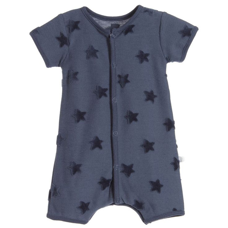 Navy blue, short-sleeved shortie by Absorba, suitable for baby girls and boys. Made in a soft cotton jersey, it has a raised, velvet star pattern and fastens at the front and between the legs with poppers, for easier dressing and nappy changes.