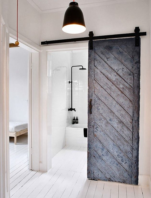 I am absolutely crazy about the rustic, white-painted wooden floor that covers all the rooms, even the bathroom. The old barn door that leads into the bathroom is so pretty and adds some roughness to this clean, white house Bathroom. WABI SABI Scandinavia - Design, Art and DIY...
