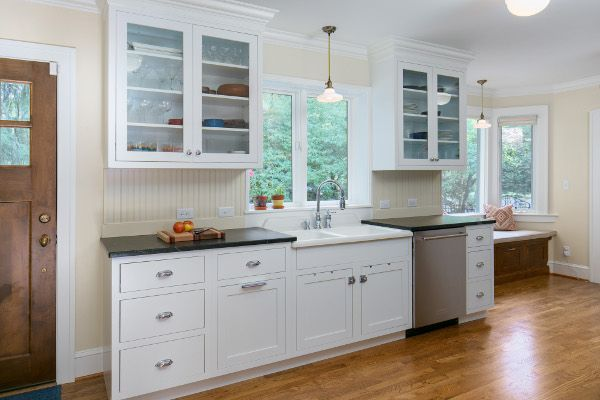 Vintage Kohler sink, glass door cabinets, beadboard backsplash, soapstone counters