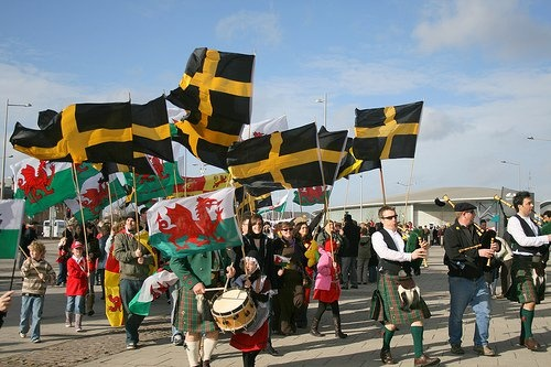 The flag of St. David (black with a gold cross) has been used to represent Wales in the same way that the crosses of St. George, St. Andrew, and St. Patrick are used to represent England, Scotland, and Ireland on their flags.