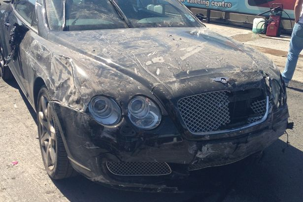 Fake valet takes £80,000 Bentley for a five star car wash - and smashes it through a brick wall.