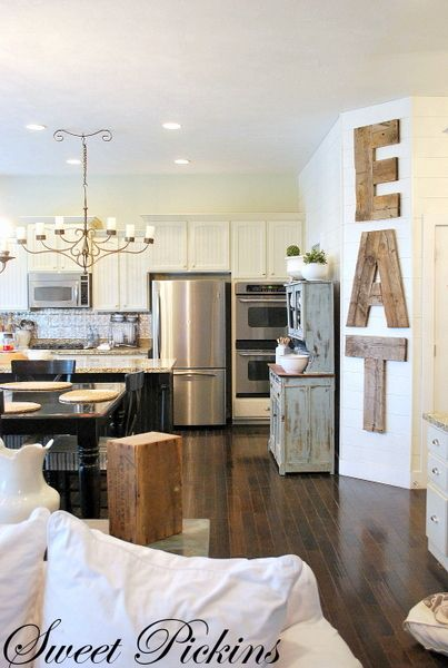 I like the mix between old & new here. Cupboard, light, wood, letters. I can even see adding some girly features (ie. Sparkly backsplash, fresh flowers) and a chunky farmhouse table.: