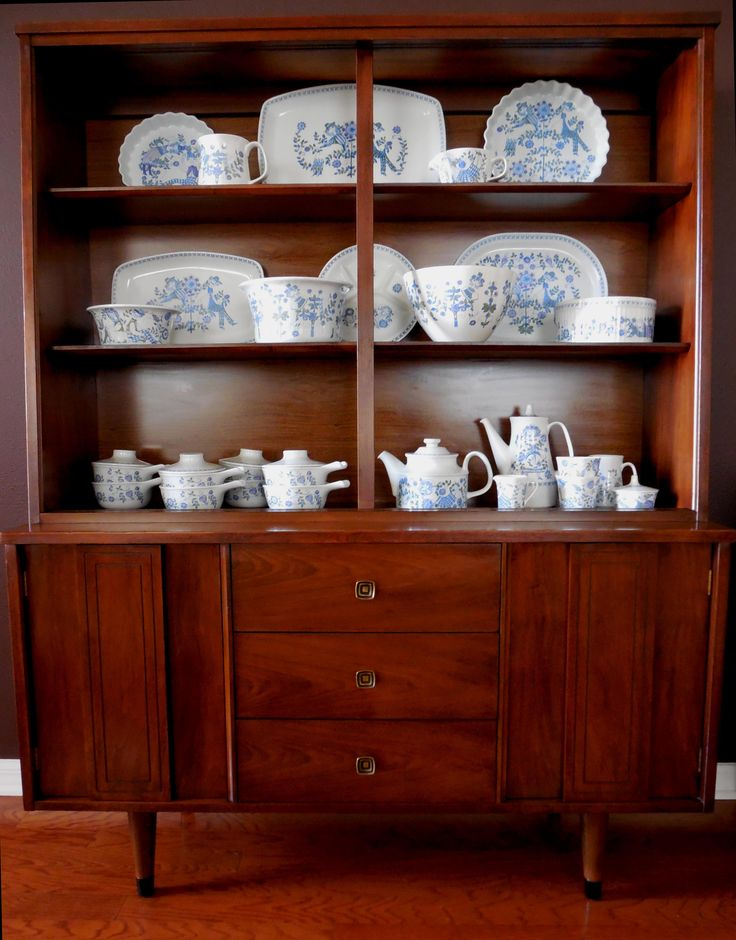 Collection of Mid Century Lotte Figgio Flint Turi Norway dishes in a Stanley hutch bookcase from MidCenturyFLA, https://www.etsy.com/listing/159334150/mid-century-credenza-hutch-buffet?ref=shop_home_active
