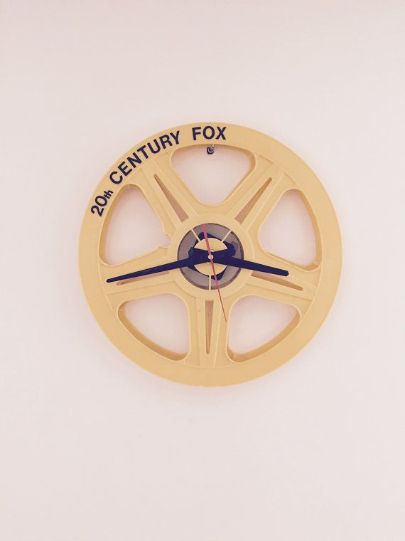 Clock made from a recycled film reel. by cinemaclok on Etsy