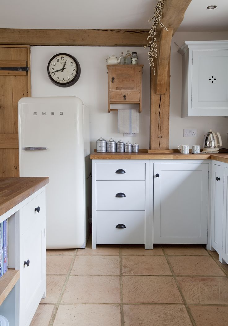 """""""Border Oak kitchen"""" This is possibly more what Harriet would choose, but I'll sneak some colour in. I like the handles but they are not very practical."""